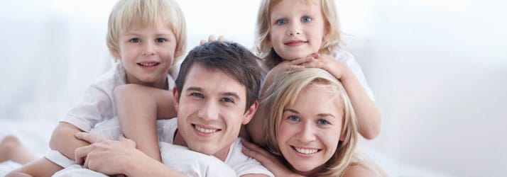 Happy family cared for by chiropractic team in Seabrook NH